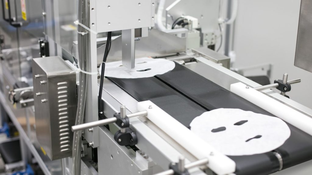 Close up image of the rpoduction machine for OEM cosmetic Facial masks at the YLS production facility